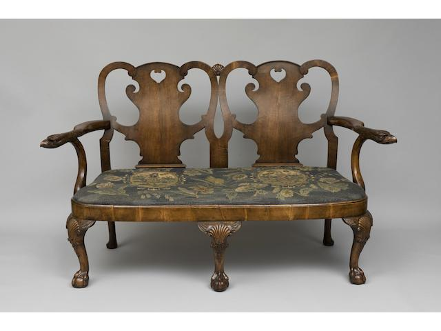 An 18th Century style walnut two seater chair back settee
