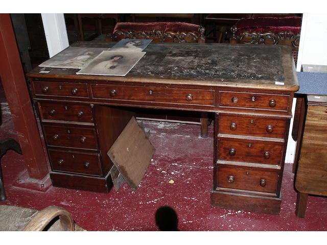 A mid Victorian mahogany pedestal desk