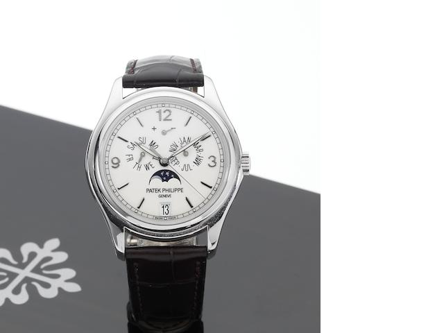 Patek Philippe. A very fine 18ct white gold automatic centre seconds wristwatch with annual calendar, moon phases and 48 hour power reserve, together with Certificate of Origin and fitted wooden boxAnnual Calendar, Ref:5146, Movement No.3557697, Case No.4366268, Sold May 21st 2007