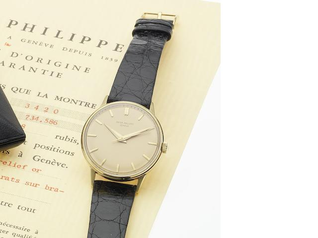Patek Philippe. A fine and rare 18ct gold centre seconds wristwatch Calatrava, Ref:3411, Case No.2607659, Movement No.707747, Circa 1950
