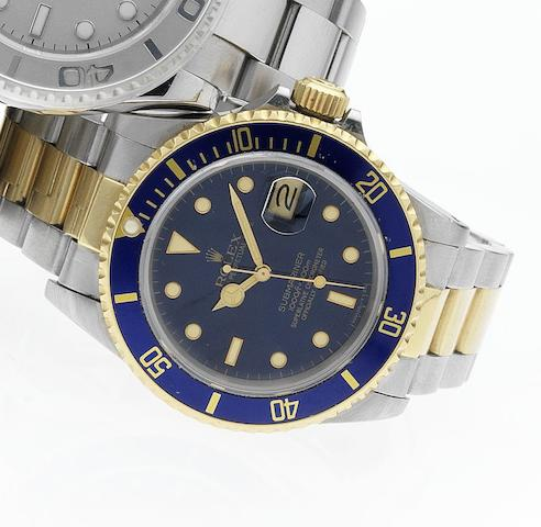 Rolex. A fine stainless steel and gold automatic centre seconds calendar bracelet watch together with original fitted box and papersSubmariner, Ref:16803, Made in 1984, Sold June 1985