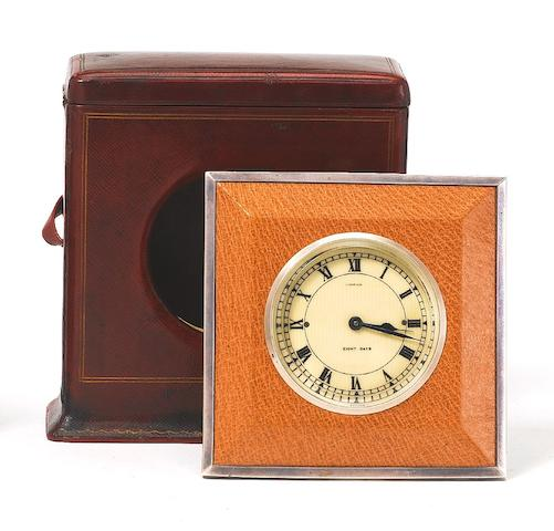 A 20th century white gold mounted leather travelling strut eight day timepiece in original presentation case Cartier, the rear cover numbered 0542