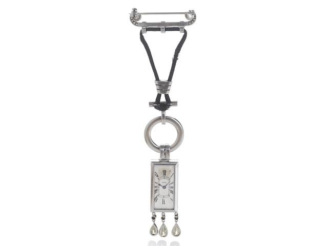 Cartier. A very fine and rare platinum, diamond and onyx set pendant watch Case No.5937, 1920's