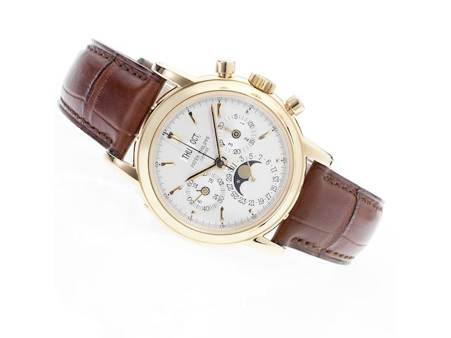 Patek Philippe. A fine and rare 18ct rose gold chronograph wristwatch with Patek Philippe strap, buckle and Extract from Archives  Ref.3970E, Movement No.3045928, Case No.4054377, Made in 1999, Sold June 16th 1999
