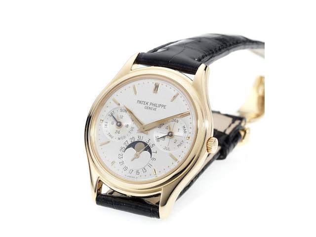 Patek Philippe. A fine and rare 18ct rose gold perpetual calendar wristwatch with 18ct rose gold deployant clasp and Extract from ArchivesRef:3940, Case No.2981617, Movement No.776493, Made in 1997, Sold January 5th 1998