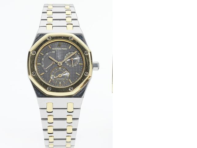 Audemars Piguet. A fine and rare stainless steel and gold dual time automatic calendar bracelet watch with power reserve indication Royal Oak, No.343, Case No.D32868, Sold May 17th 1995