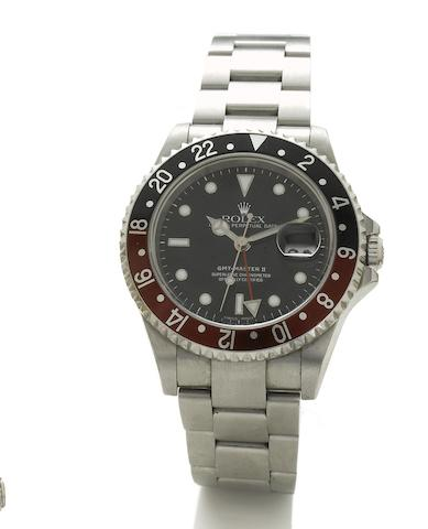 Rolex. A fine stainless steel automatic centre seconds calendar twin time zone bracelet watch together with fitted box and papers GMT-Master II, Ref:16710, Sold November 9th 2005