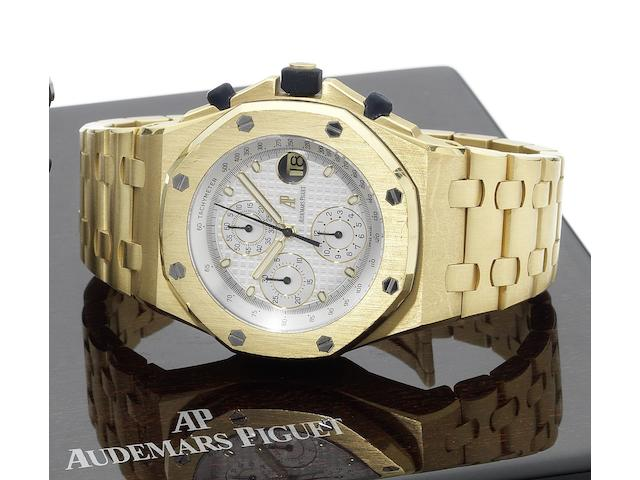 Audemars Piguet. A fine and large 18ct gold automatic chronograph calendar wristwatch  with concealed double deployant clasp and fitted box & papers  Royal Oak Offshore, No.0496, Case No.F45566, Recent
