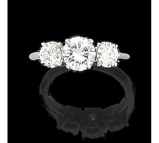 A diamond three-stone ring, by Tiffany & Co.