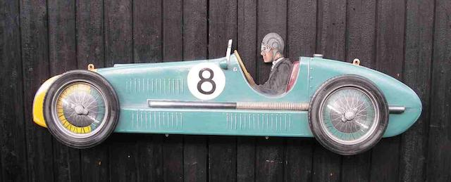 A hand-painted wooden profile of a Maserati 4cl,