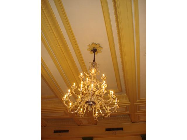 A large early 20th century Venetian clear glass and gilt decorated twenty-light chandelier