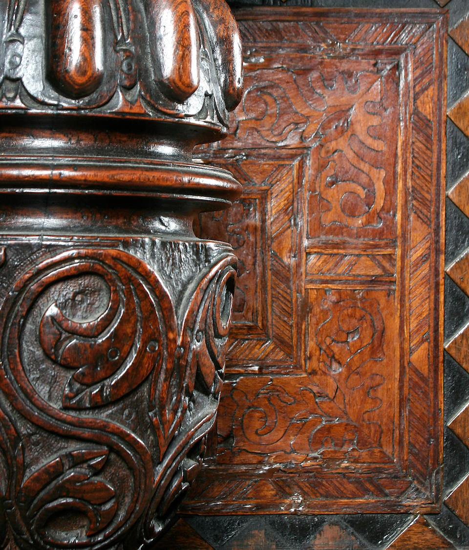 An early 17th Century oak and marquetry inlaid court cupboard