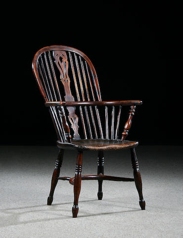 A mid 19th Century yew, fruitwood and elm high back Windsor chair