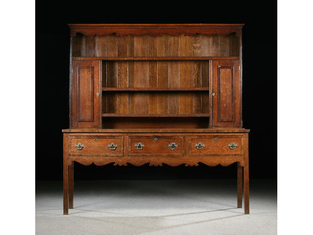 An early 19th Century  oak and mahogany crossbanded high dresser