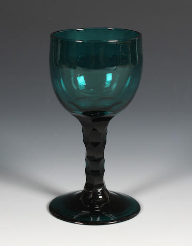 A green-tinted facet-stem wine glass Circa 1780.