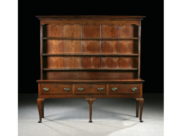 A mid 18th Century oak high dresser