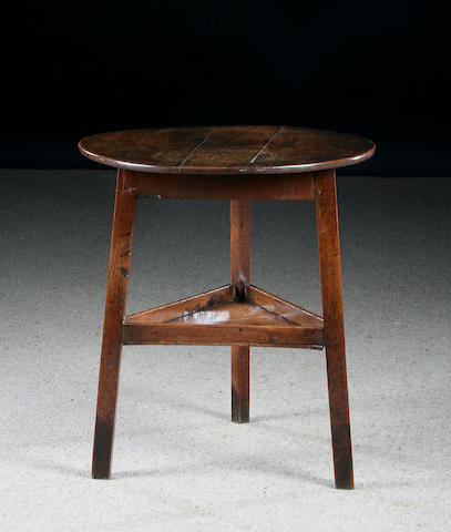 An early 19th Century  oak and elm cricket table, circa 1800