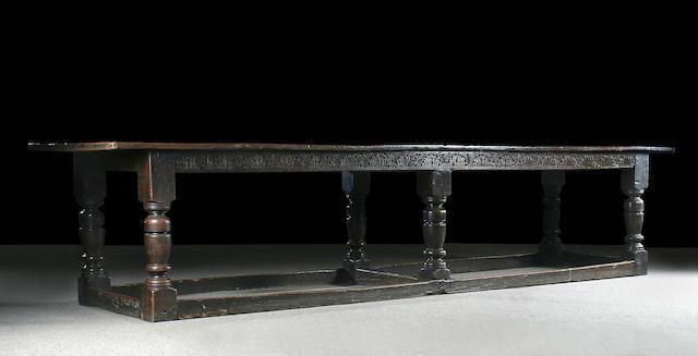 A rare mid 17th Century large oak six leg refectory table