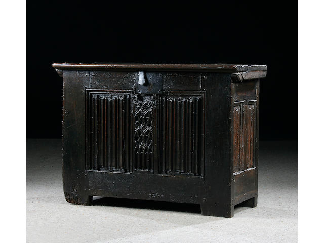 A rare 16th Century linen fold coffer, of slender proportions