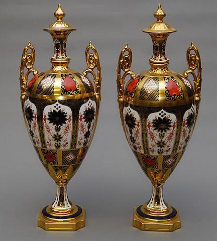 A large pair of Crown derby Imari vases