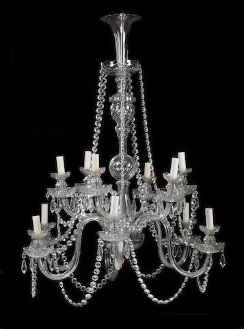 A George III style cut glass twelve light chandelier
