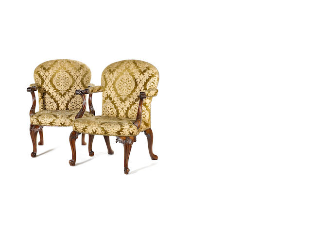 A fine pair of early George III carved mahogany Library Open Armchairsin the manner of Thomas Chippe
