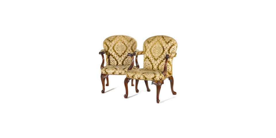 A fine pair of early George III carved mahogany Library Open Armchairsin the manner of Thomas Chippendale
