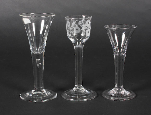 Three plain stem wine glasses Mid 18th Century.