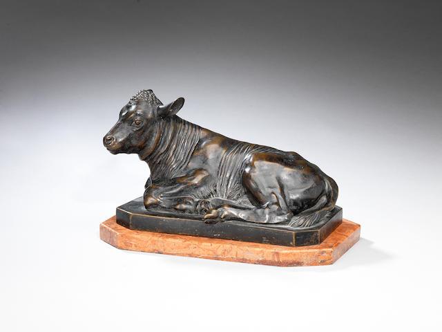 A 19th century bronze statue of a recumbent calf