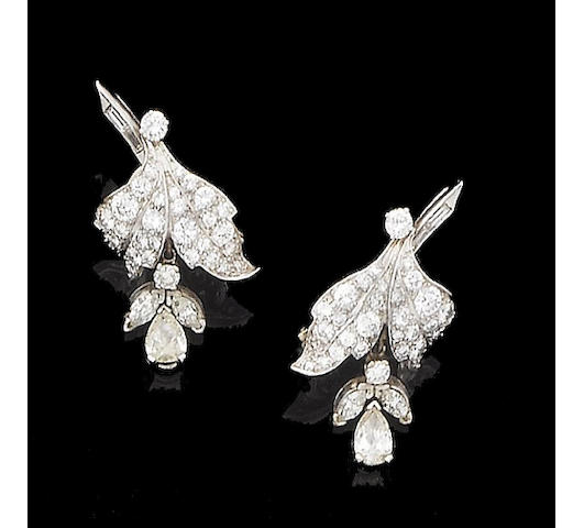A pair of diamond earclips, by Van Cleef and Arpels,