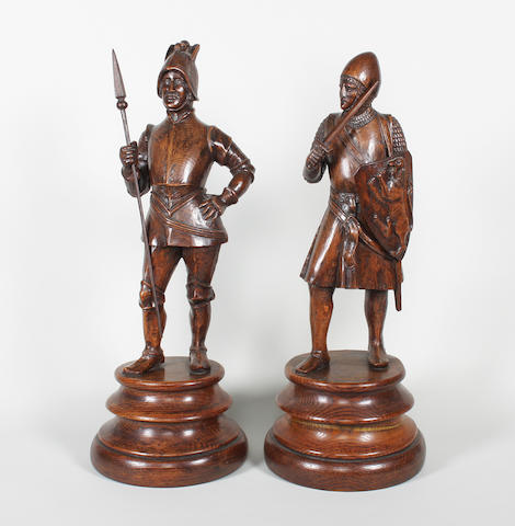 A pair of 19th century carved oak figures of 17th century soldiers