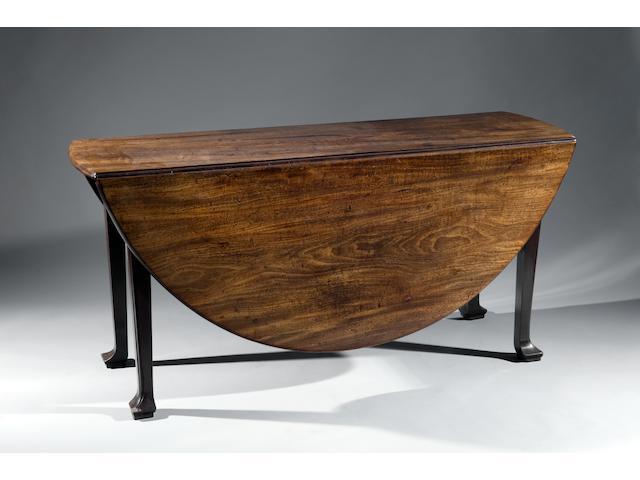 A George II large oval mahogany drop leaf table