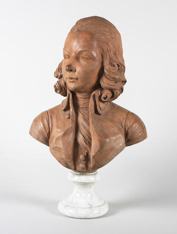 A terracotta bust of a young boy, possibly Mozart