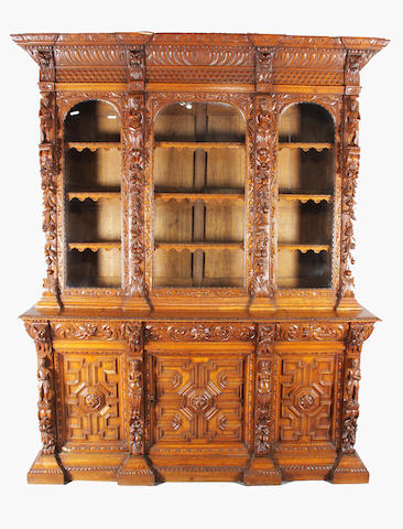 An impressive 'Jacobethan' late 19th century carved oak bookcase