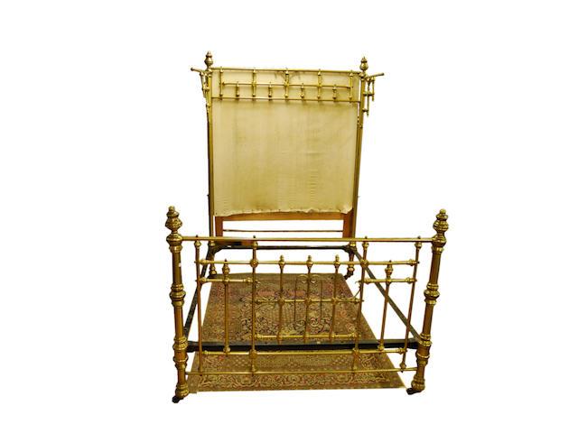 A Victorian brass half-tester bed