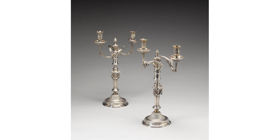 A pair of George III cast silver two-light candelabra in the manner of Robert-Joseph Auguste, by Par
