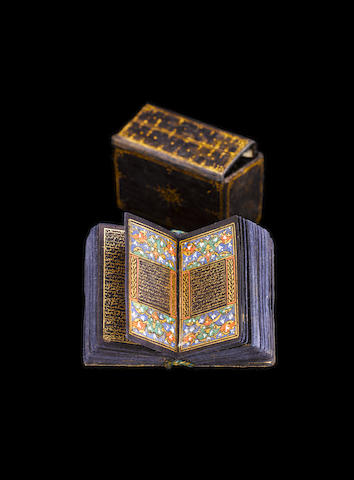 A miniature Qur'an written in gold on blue paper