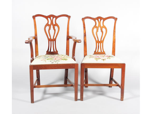 A set of twelve Edwardian Chippendale style dining chairs