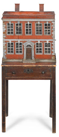 A Early 19th century dolls house on stand with garden
