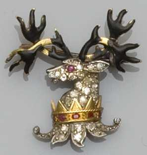 A diamond and enamel heraldic crest brooch