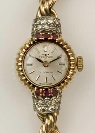Technos: An 18ct gold ruby and diamond set lady's cocktail watch Circa 1950's