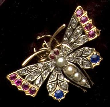 A mid-late Victorian gem set butterfly brooch