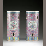 A pair of famille rose cyllindrical vases (one repaired) Tongzhi seal marks (19th century)