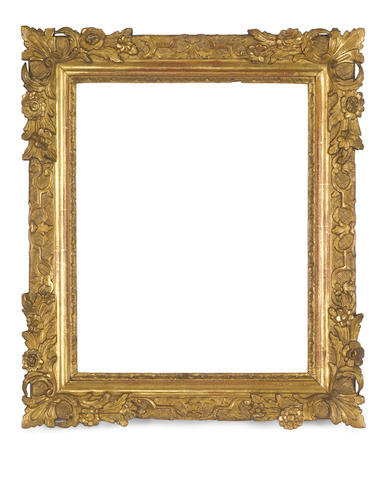 A Provincial 18th Century carved and gilded frame