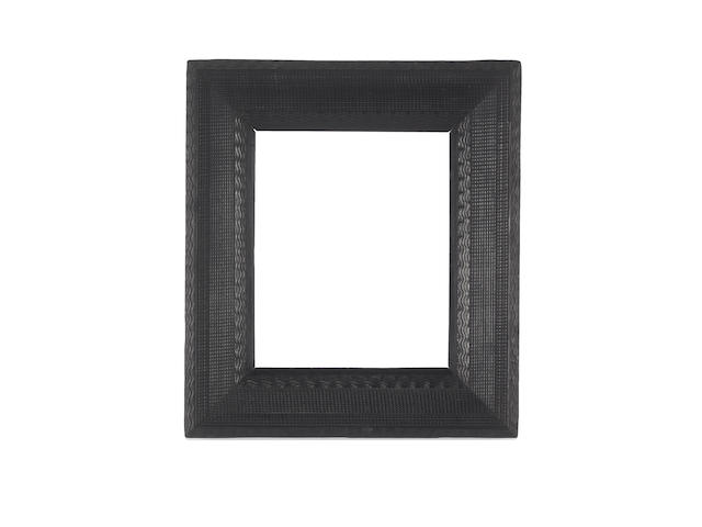 A Dutch 17th Century ebony ripple moulding frame