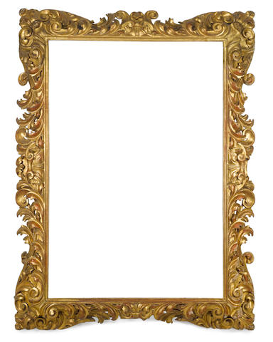 A Florentine 19th Century carved, pierced and gilded frame