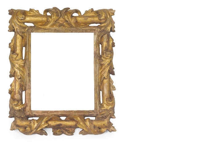 A Bolognese 17th Century carved, pierced and gilded frame
