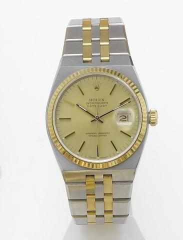 Rolex. A fine and rare stainless steel and gold centre seconds calendar bracelet watch together with original Oyster quartz box and papers Oysterquartz, Datejust, Ref:17000B, Made in 1985, Sold in 1989