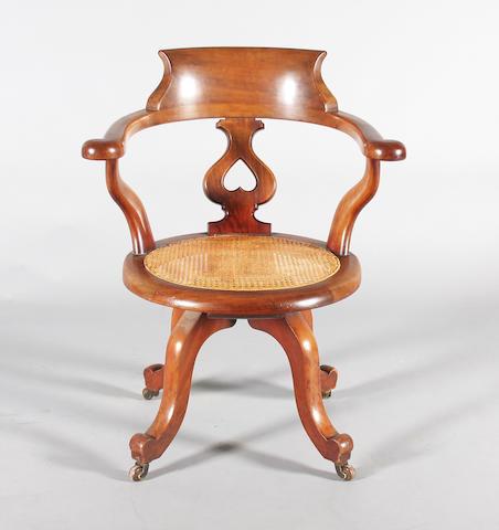 A late Victorian mahogany swivel desk chair
