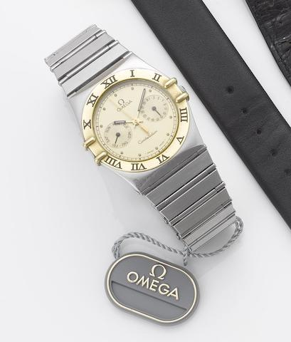 Omega. A stainless steel and gold centre seconds calendar bracelet watch together with fitted box and papersConstellation, 1990's